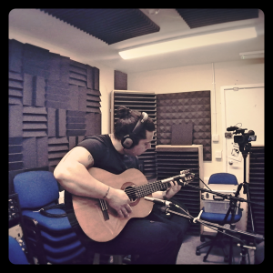 Private Guitar Lessons Chichester - Ian playing guitar at Chichester University recording studio